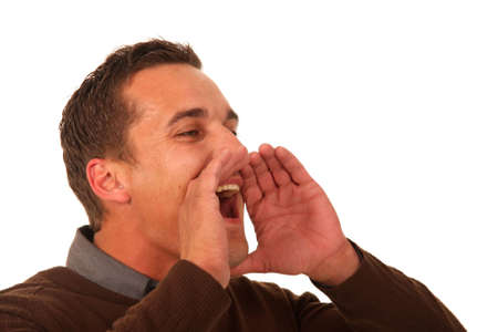 announcing: Young man shouting with hands cupped to his mouth