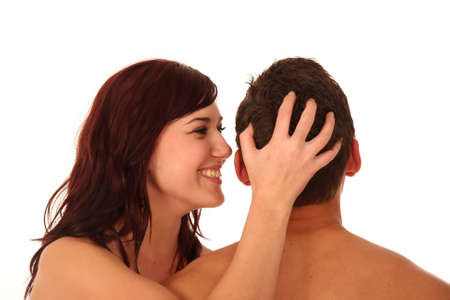 Sexy couple with woman whispering in mans ear photo