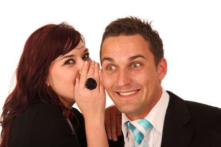 Beautiful brunette woman whispering into her boyfriends ear photo