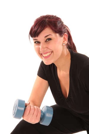 Beautiful young lady exercising with weights Stock Photo - 5604465