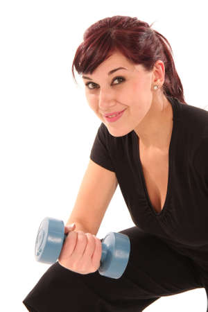 Beautiful young lady exercising with weights Stock Photo - 5604468