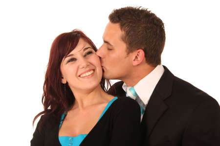 hansome: Hansome man kissing his beautiful smiling girlfriends cheek Stock Photo