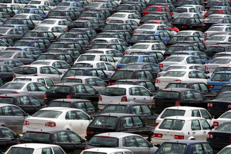 Brand new motor vehicles in a parking lot waiting for export Stock Photo