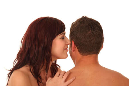 Beautiful brunette woman whispering to her boyfriend photo