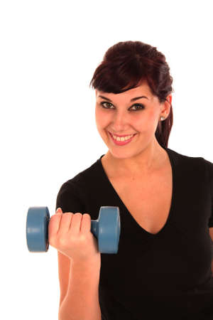 Beautiful young lady exercising with weights Stock Photo - 5827776