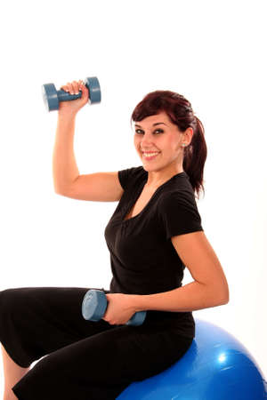 Beautiful young lady exercising with weights photo