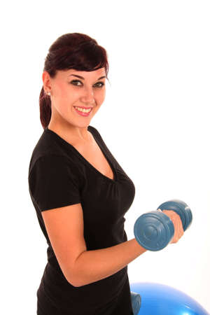 Beautiful young lady exercising with weights Stock Photo - 5827775