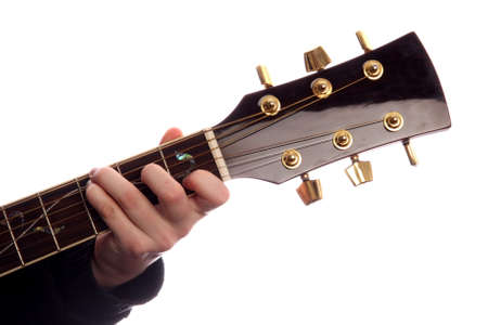 chord: Acoustic guitar with persons fingers playing C Major chord