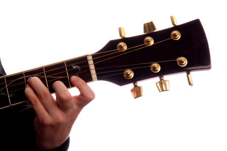 e guitar: Acoustic guitar with persons fingers playing E Major chord Stock Photo