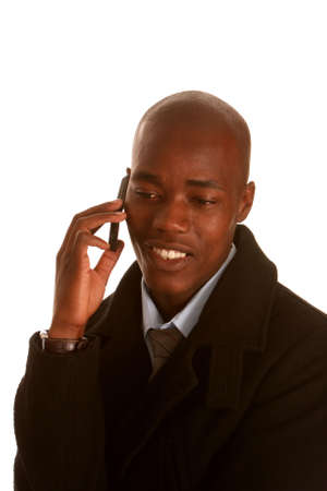 man phone: Young African businessman talking on his cell phone