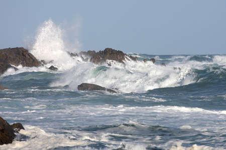 Stormy seas and crashing waves on rocks Stock Photo - 6419914