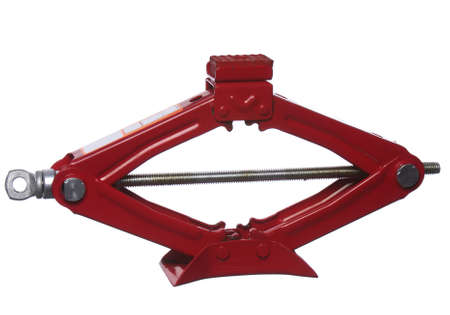 Red scissor jack or car lifter isolated on white background photo