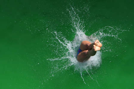 cool down: Diver entering the water with a splash