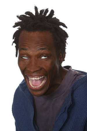 Young black man with dreadlocks hairstyle and crazy look on face