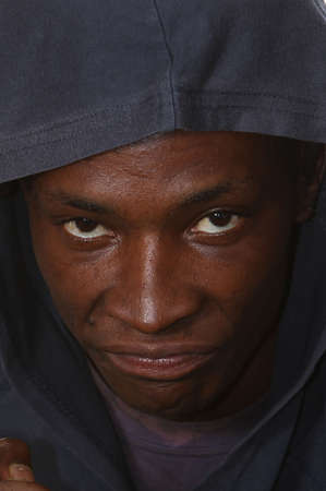 hoodlum: Angry young black man with hood over his head