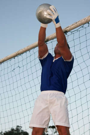 the keeper: Soccer goal keeper stretching to save the ball