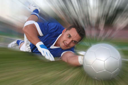 diving save: Goalkeeper diving to stop the soccer ball - special effect Stock Photo