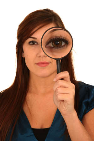 Beautiful girl holding magnifying glass showing big eye Stock Photo - 7197251