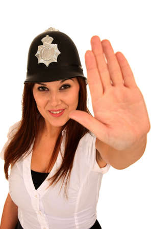 policewoman: Beautiful brunette woman wearing a toy police hat and hand out in stop sign