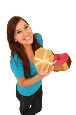 Beautiful brunette lady opening a gift box with cash inside Stock Photo - 7197276