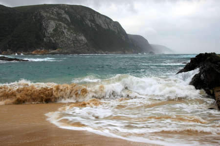 rushing water: Sandy beach with rushing water at Storms River Mouth - South Africa