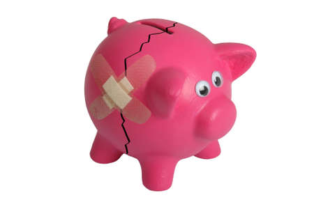 Pink piggy bank with eyes and and bandaged crack - isolated photo