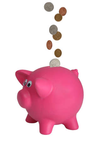 coppers: Money coins falling into a piggy bank - coins with motion blur