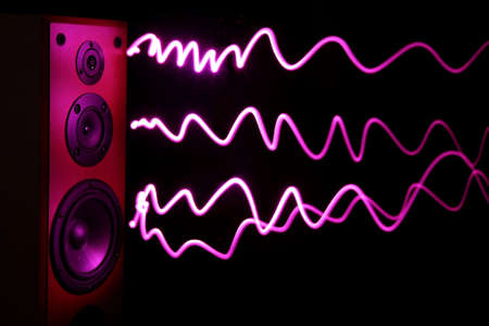Audio speakers in a wooden cabinet with light effect for sound waves Stock Photo - 7547206