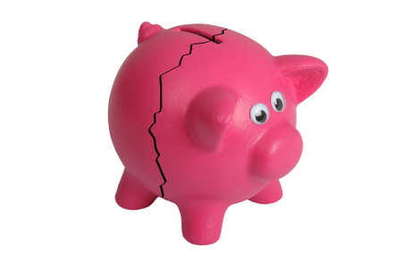 Pink piggy bank with eyes and and crack - isolated photo