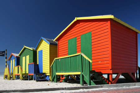Brightly painted summer beach change rooms at the sea side in Cape Town photo