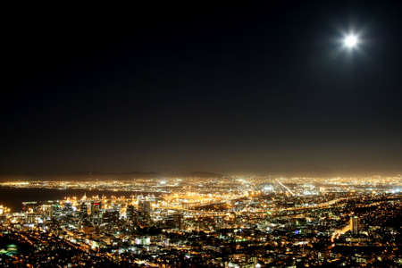 night: Cape Town harbor and city at night with moon in the sky