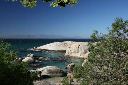 turqoise: Granite boulders and turqoise sea water on the coast in South Africa