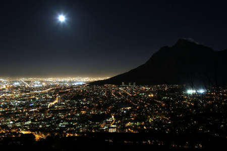 night star: Cape Town city at night with moon in the sky Stock Photo