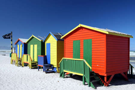 Brightly painted summer beach change rooms at the sea side in Cape Town