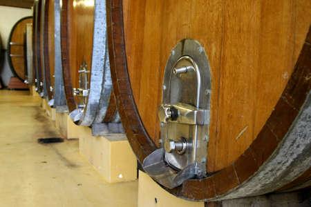 Wine casks or barrels in a wine cellar photo