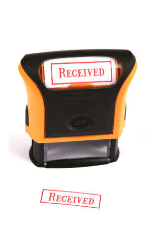 received: Self inking rubber stamp with the word Received Stock Photo