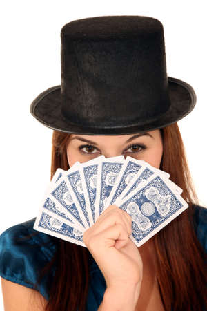 Beautiful  brunette girl in black hat holding playing cards Editorial