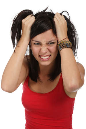 Pretty young lady with frustrated look and hands in her hair Stock Photo - 8433194