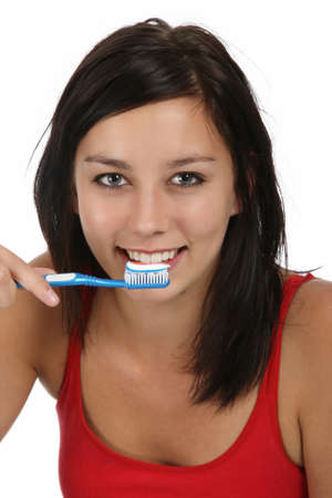 helthcare: Lovely brunette woman with tooth paste and brush Stock Photo