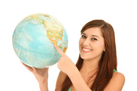 Pretty smiling young lady holding a world globe and pointing to America Stock Photo - 8485040