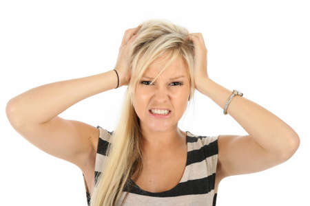 Frustrated pretty blonde woman with hands on her head Stock Photo - 8862179