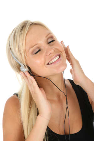 Gorgeous blonde girl listening to music on her earphones photo