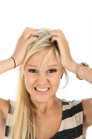 Frustrated pretty blonde woman with hands on her head photo
