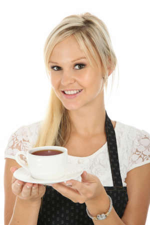 Beautiful smiling waitress with a cup of hot tea photo