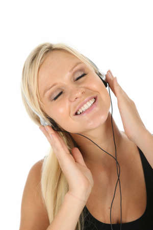 Gorgeous blonde girl listening to music on her earphones Stock Photo - 8933544