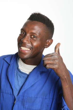 Smiling African worker man with thumb up sign photo