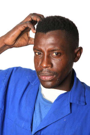 Worried African man scratching his head photo