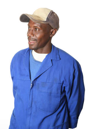overalls: Happy smiling African man wearing a cap and isolated on white background