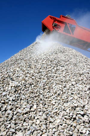 Conveyor and pile of quarry stone for building sorted according to size Stock Photo - 9111044