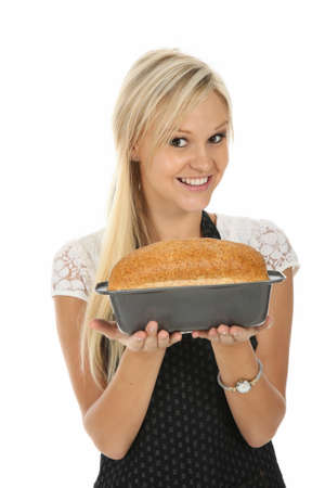 Gorgeous blond woman with home baked loaf of bread